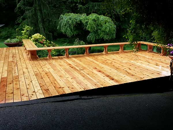We replaced the orginal 2,000 sq. ft. deck on this West Olympia home with a new cedar deck. Point to the picture to see what it looked like before this transformation.