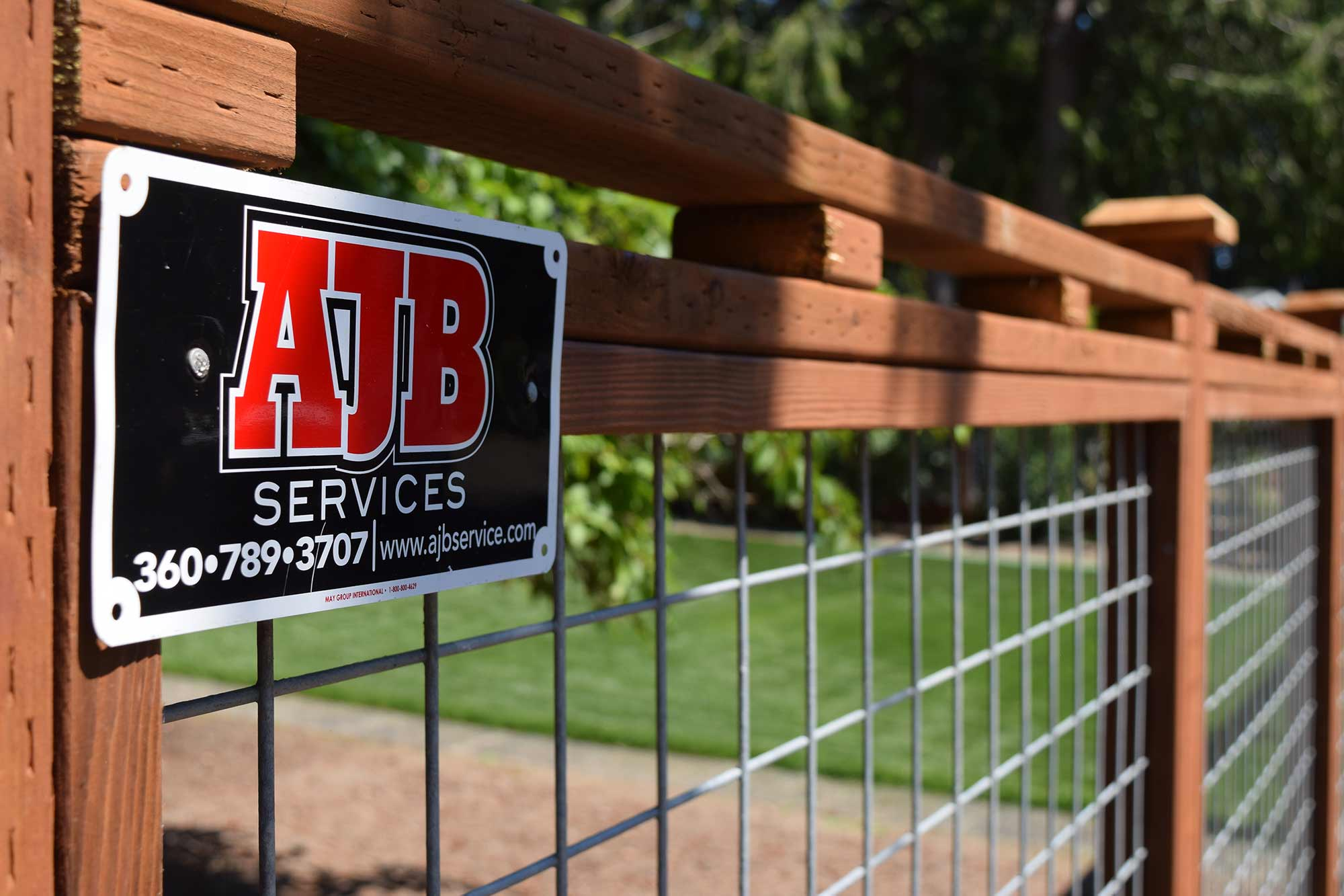Made by AJB: this deer fence protects the front yard of this Cooper Point home from wildlife while still allowing the family to feel part of the neighborhood.