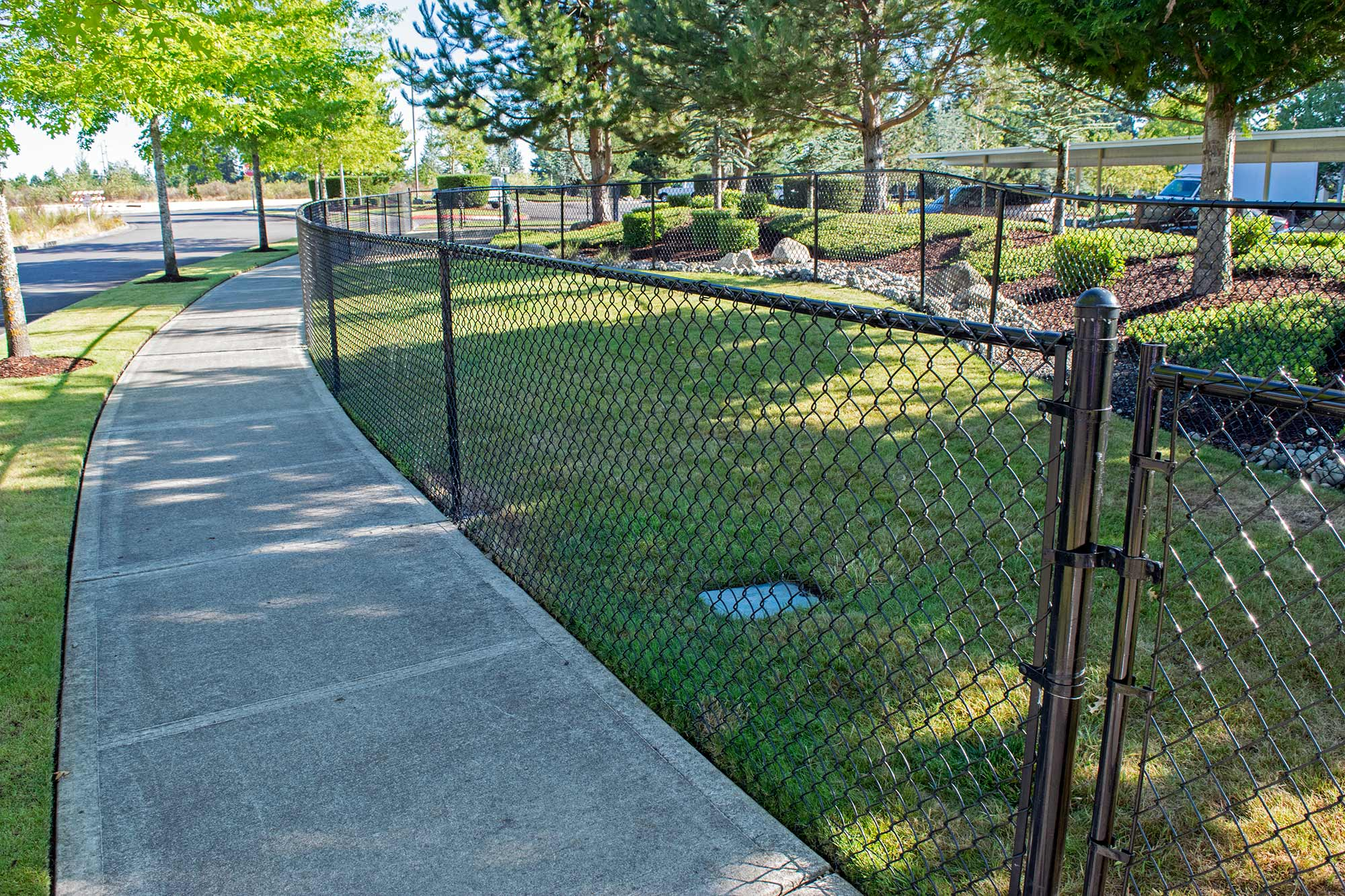 This beautiful, gated off-leash dog area runs adjacent to the sidewalk running through this Dupont retirement community, providing easy access and a safe environment for dogs and their owners.