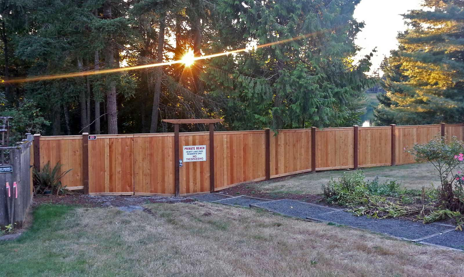 Hewett Lake security and privacy fence prevents the public from entering this private lakefront community.