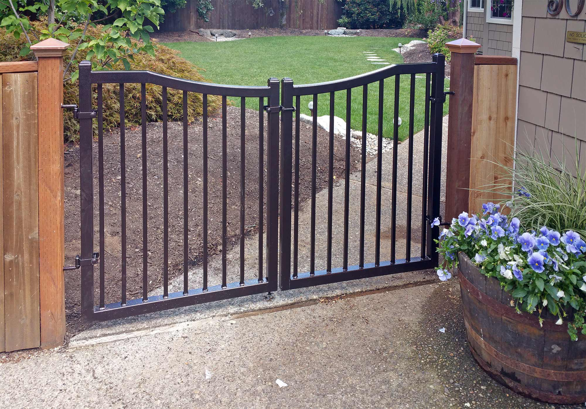 Ornamental iron access gate, powder coated with hammered copper finish. Point to the image to see how it looked before. Click the image to see a larger view.