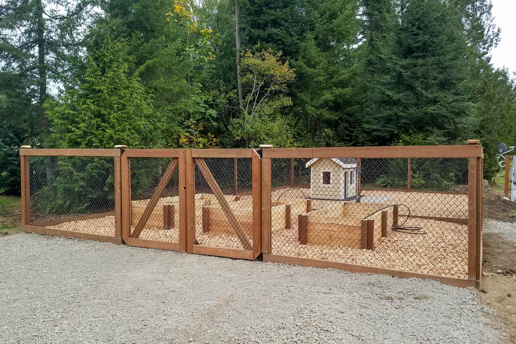 AJB Landscaping & Fence built this unique outdoor dog kennel that doubles as a raised garden.