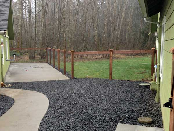 Kennel fence installed as part of a cement pad and pathway project