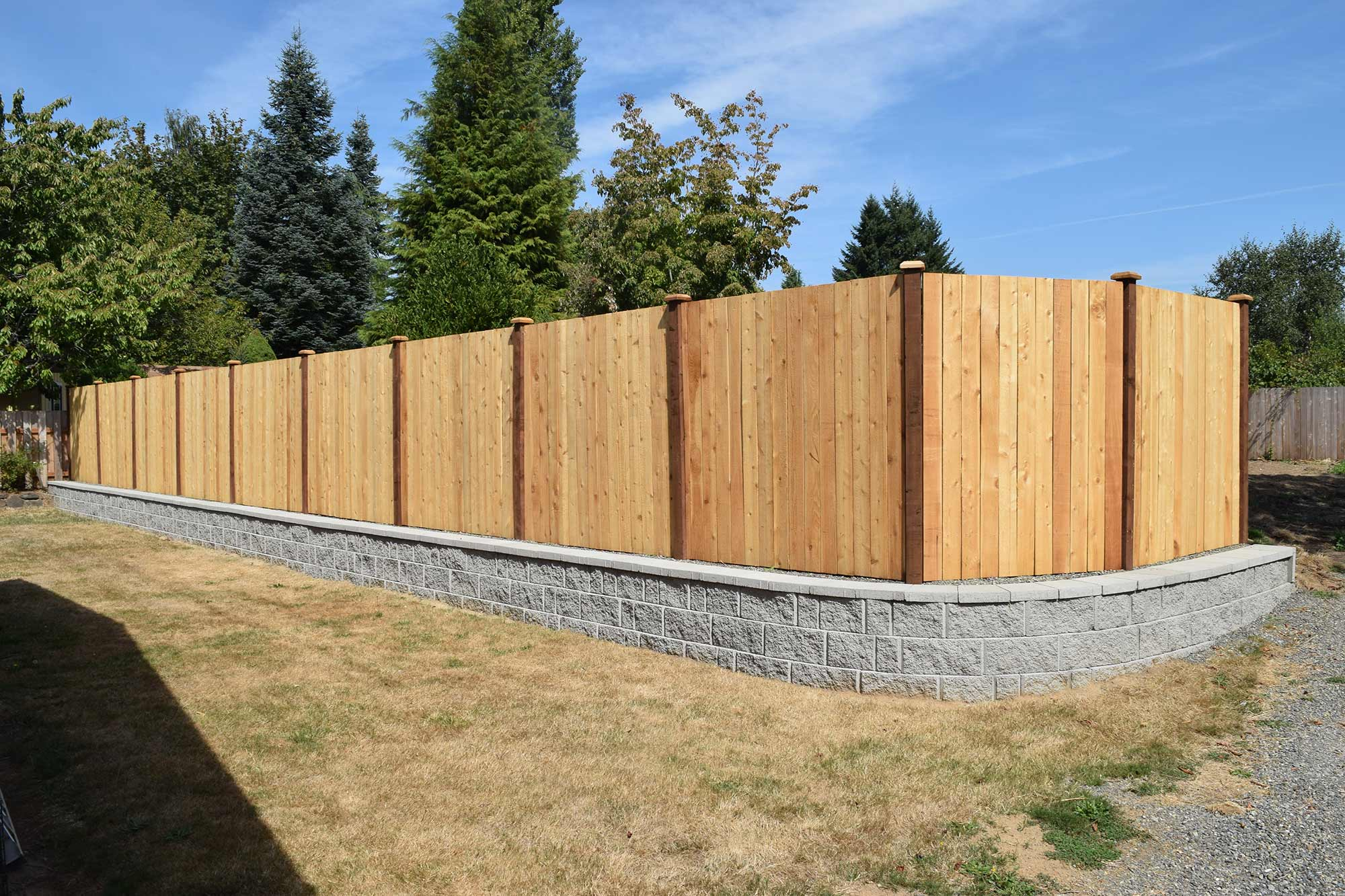 AJB Services built this retaining wall and wood fence to divide a panhandle lot from the original home and front parcel.