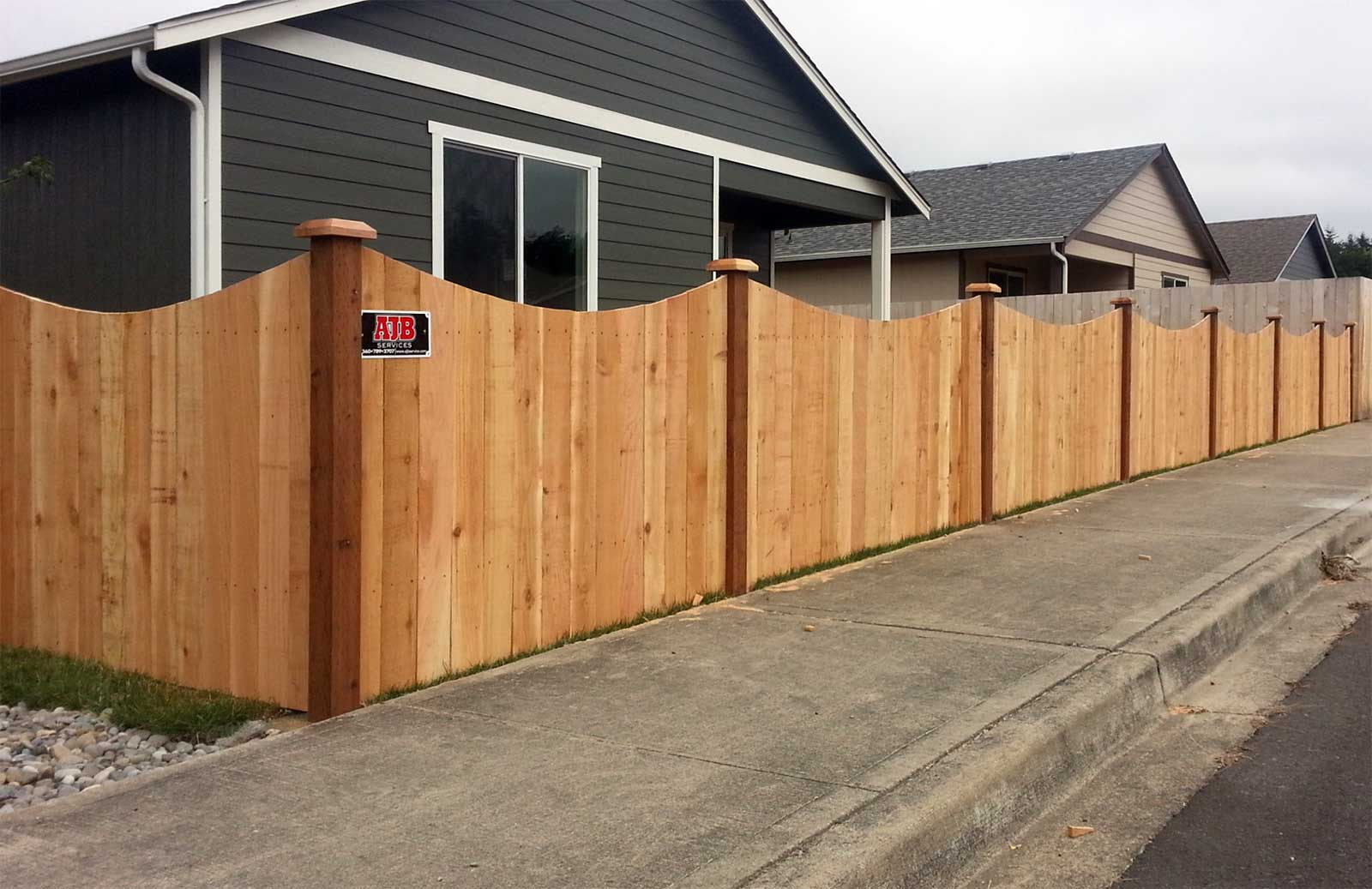 Cedar fence with scalloped top profile in Rochester, Washington