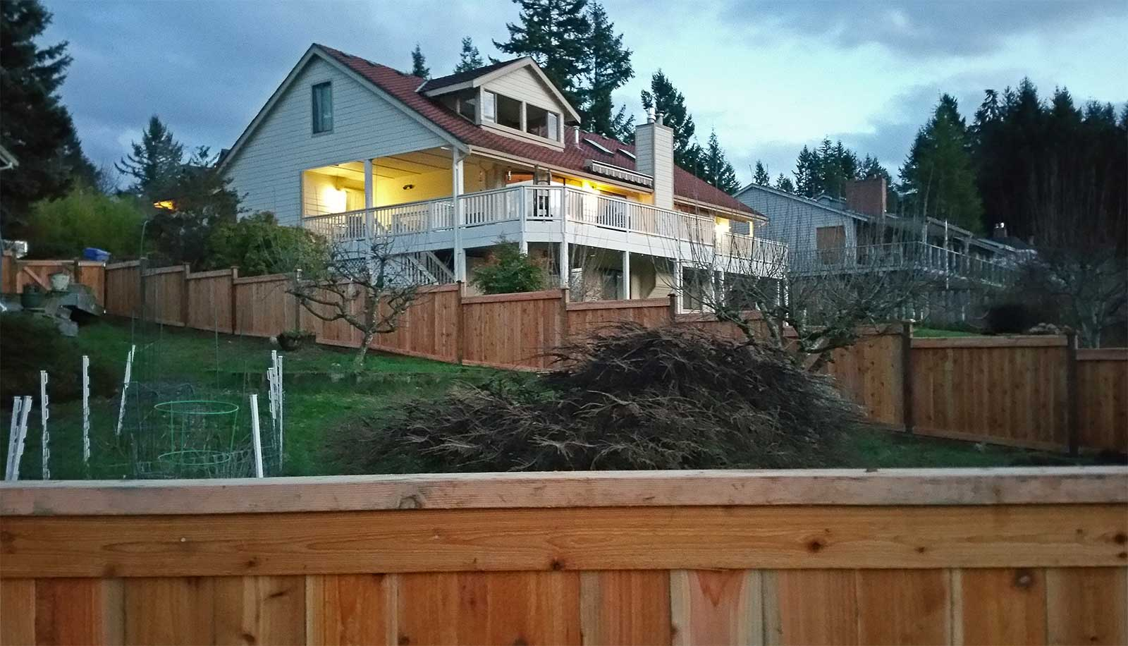 This step-down fence in Steilacoom maintains a level surface on the top while confirming to the grade of the hill.