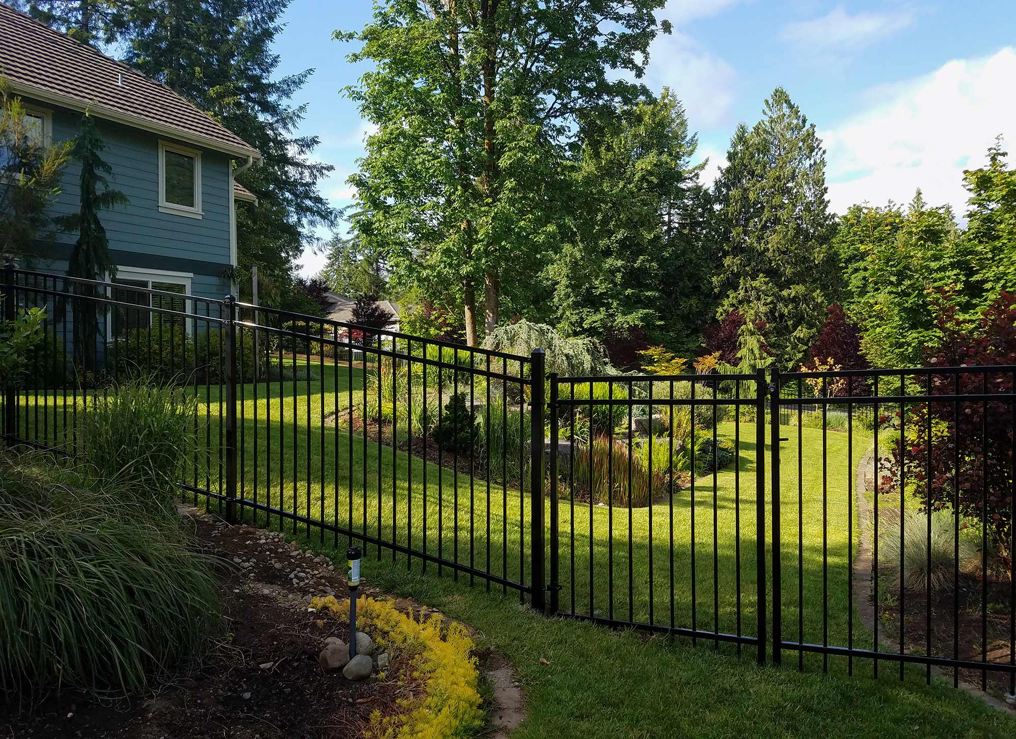 AJB installed this ornamental iron fence for this estate in West Olympia.