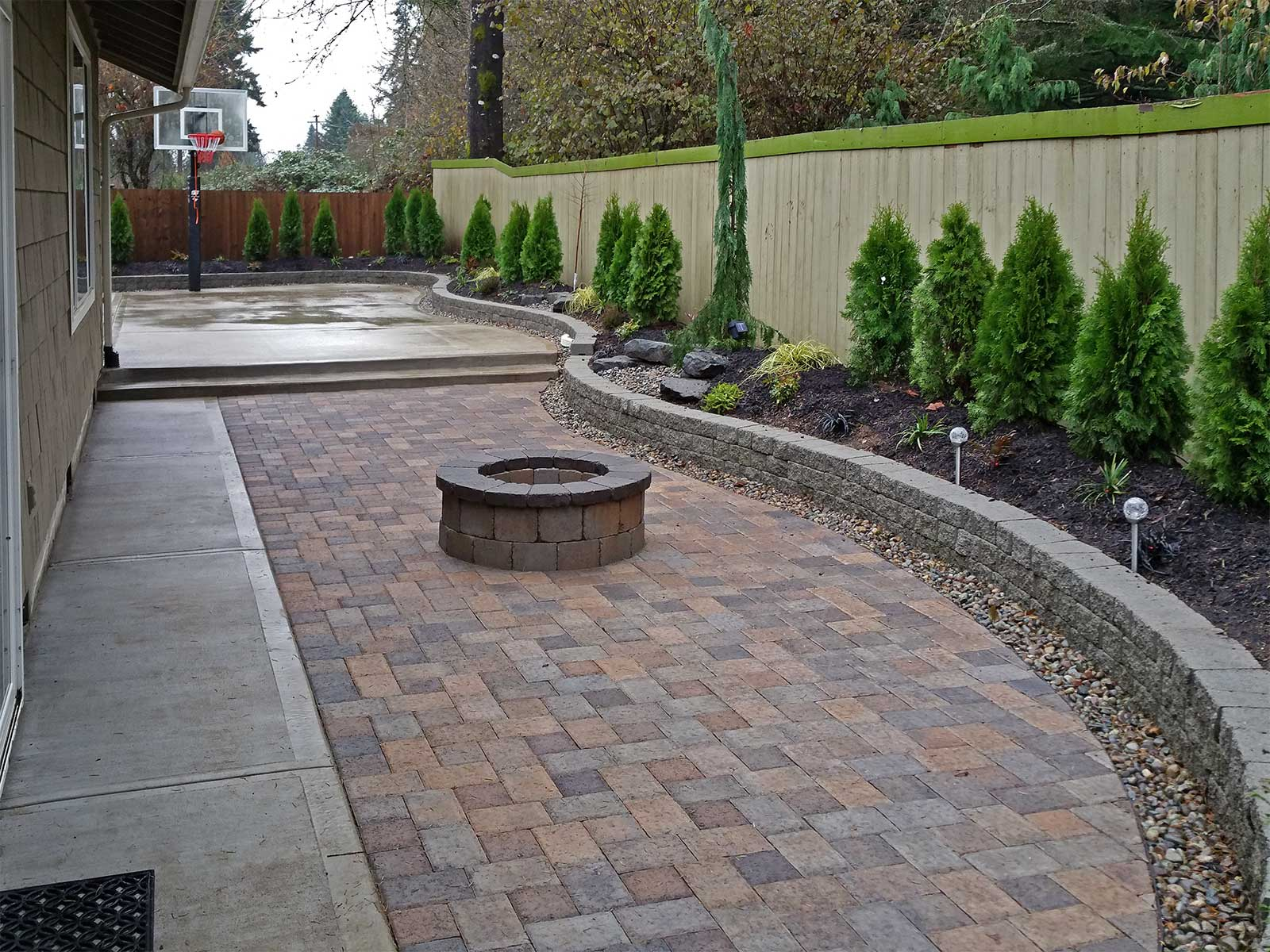Backyard Paver Patio Connected To A Concrete Slab Basketball Court. Point  To The Photo To
