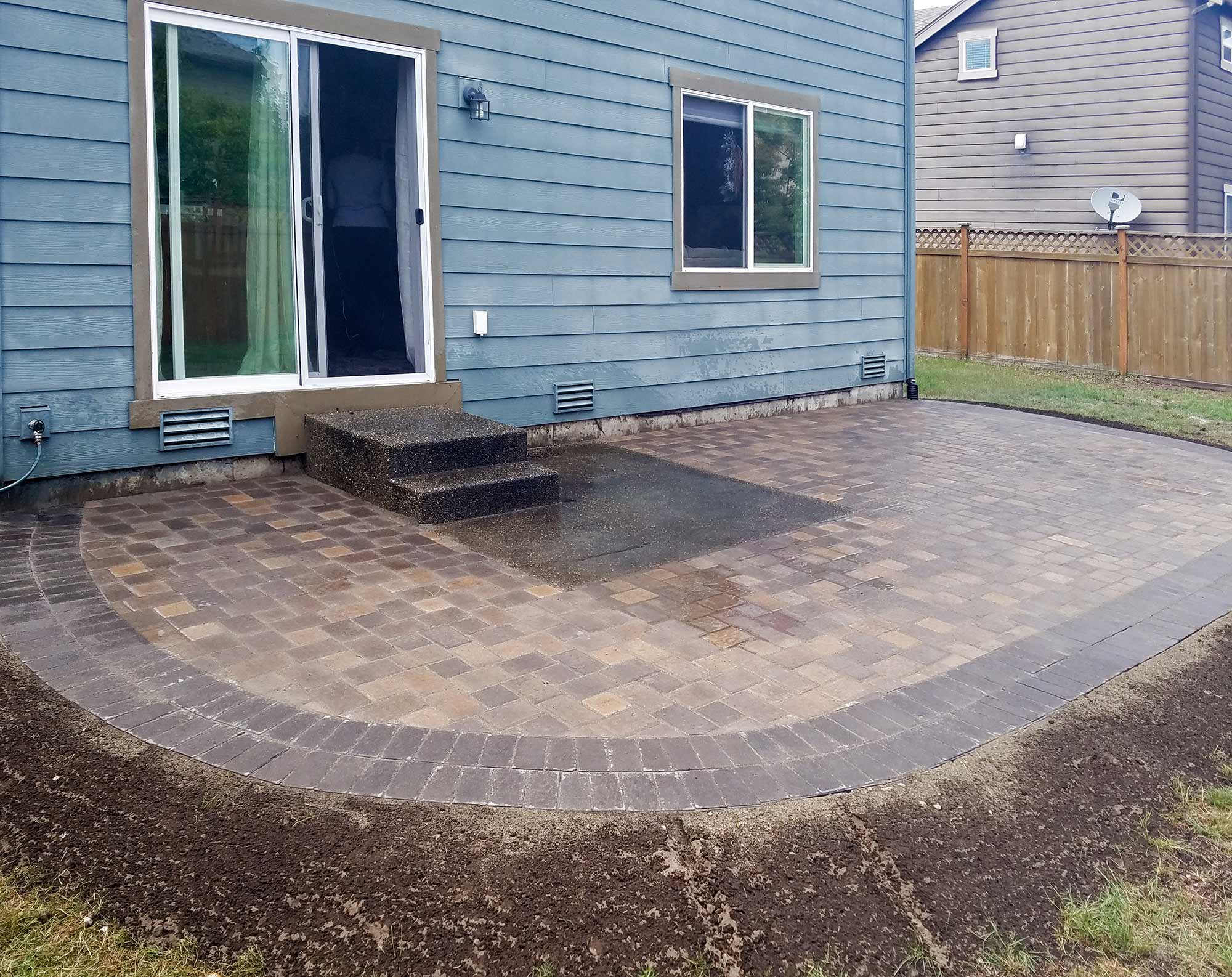 Paver patio extension features Western Interlock Slimline Columbia pavers with a double border.