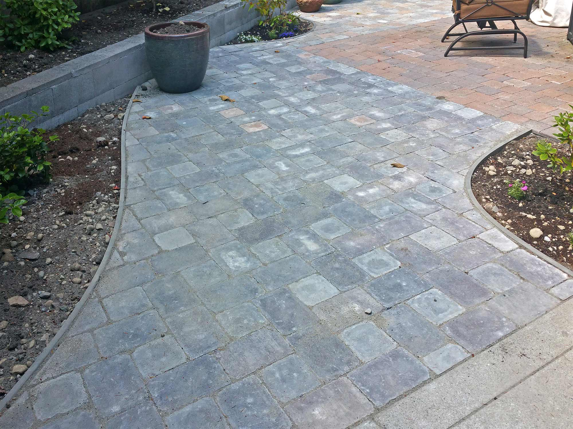 The new paver extension creates a more unique space while also connecting with concrete slabs on both sides.