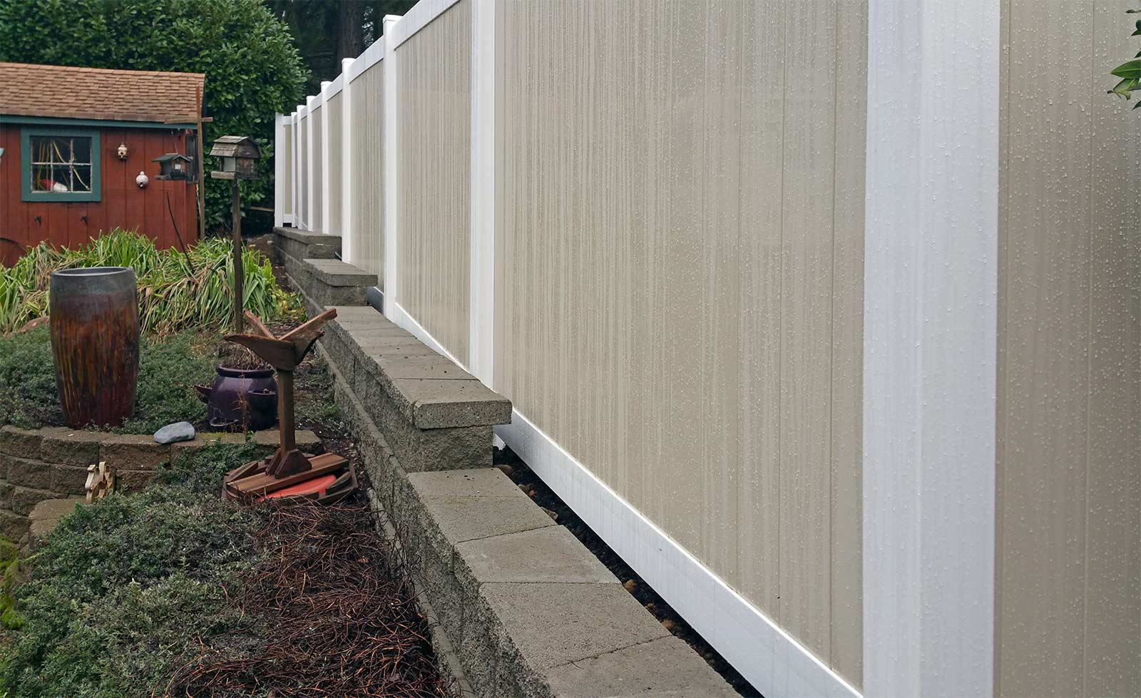 Tiered retaining wall with vinyl fencing in west olympia ajb durable vinyl fencing durable vinyl fencing baanklon Image collections