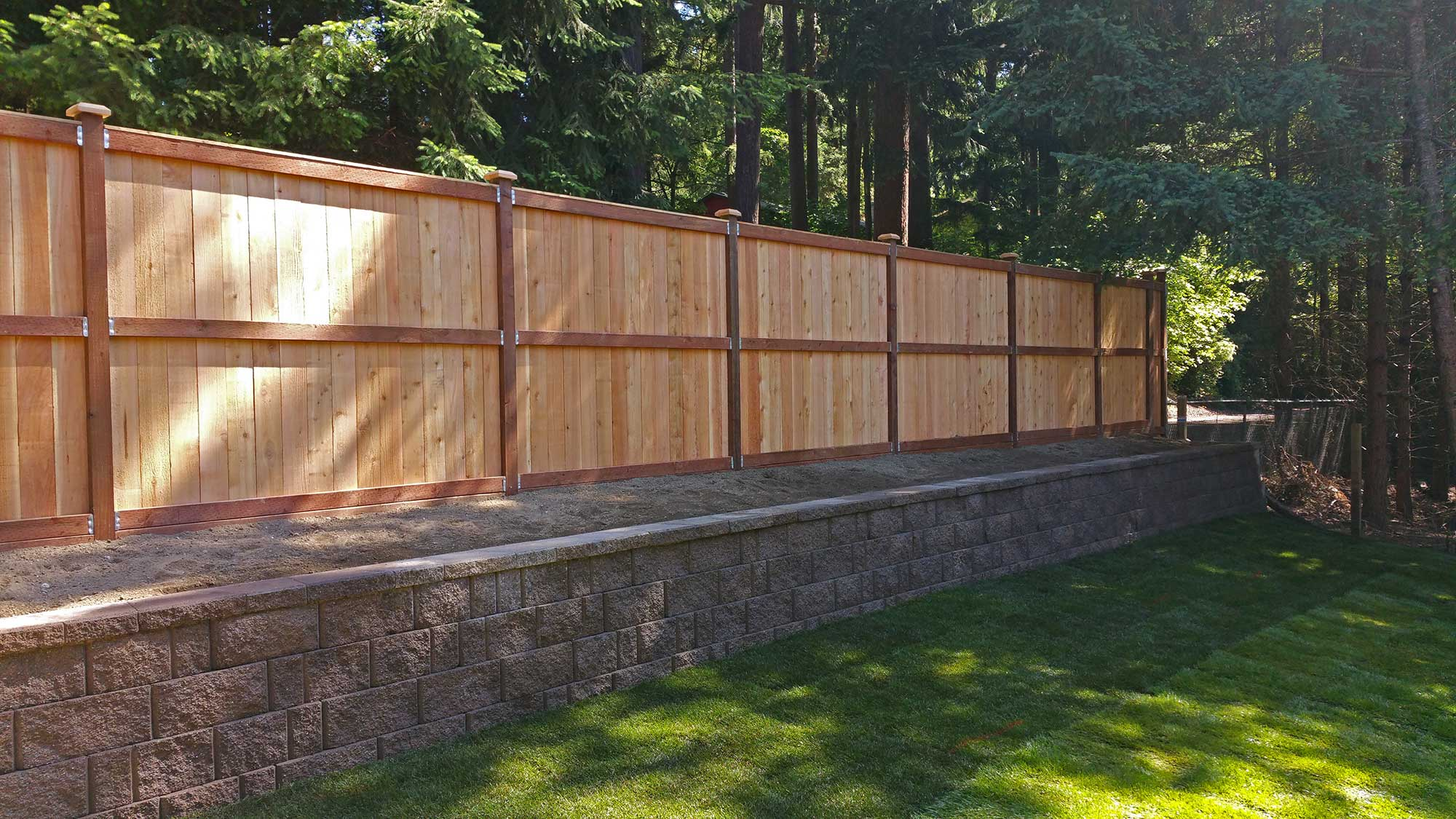 Lacey Retaining Wall and Privacy Fence sod