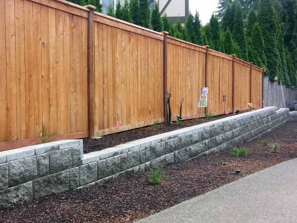 Retaining Wall with Fence by AJB Landscaping & Fence